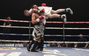 Referee Hugh Russell Jnr intervenes to prevent serious injury to Paddy Barnes