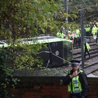 At least 7 people die as driver of derailed Croydon tram arrested