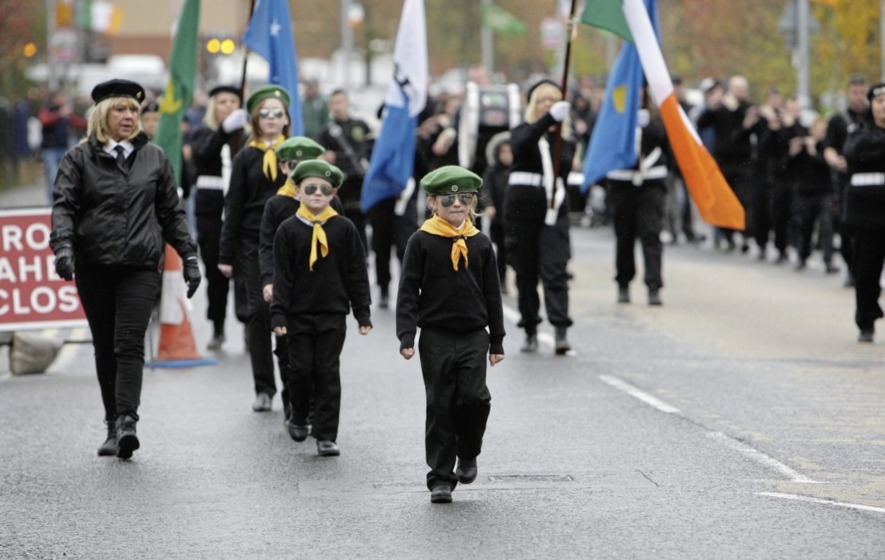 Children in paramilitary uniform take part in republican parade