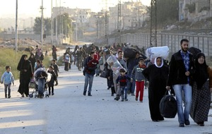 Thousands flee eastern Aleppo as Syrian forces advance