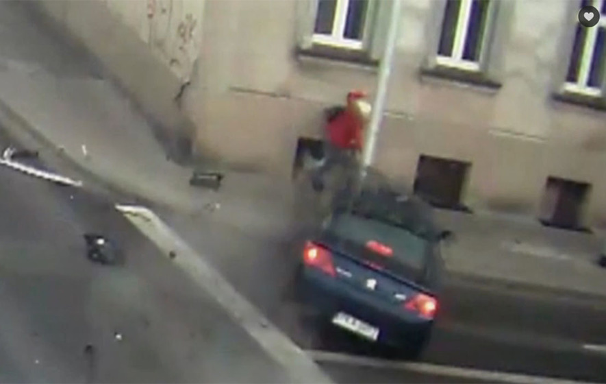Video: Lamp post saves woman from being hit by car