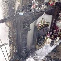 Living room of west Belfast home damaged after Christmas decoration falls onto lit candle
