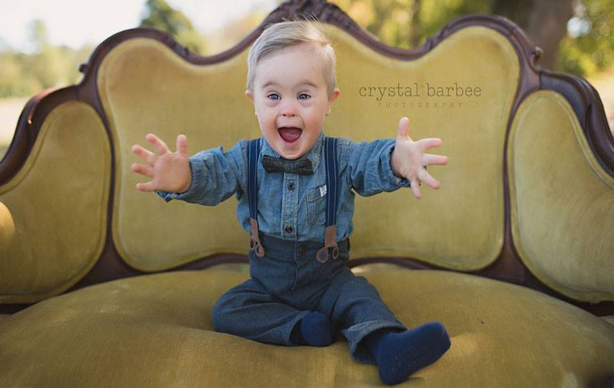 This adorable little boy with Down's Syndrome has landed a modelling gig - after his pictures were initially rejected
