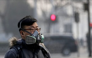 Flights delayed and roads closed as parts of China engulfed in smog