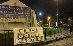 Martin McGuinness hailed with 'Well done Martin' sign in his native Derry