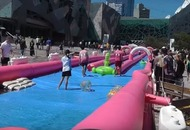 Melbourne's giant waterslide looks so ridiculously fun you'll forget how cold you are in the UK