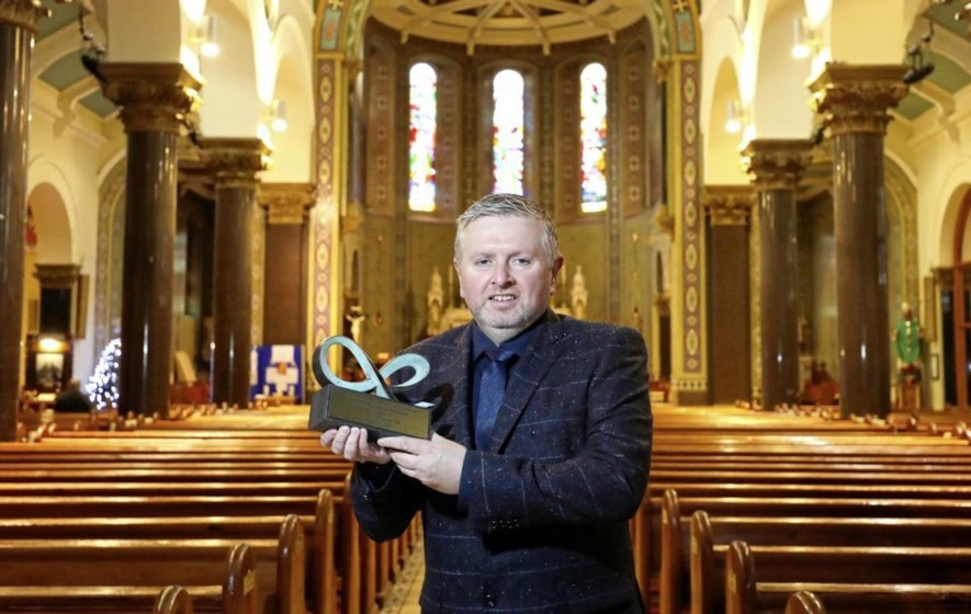 Former Ardoyne priest Fr Gary Donegan recognised with community relations award