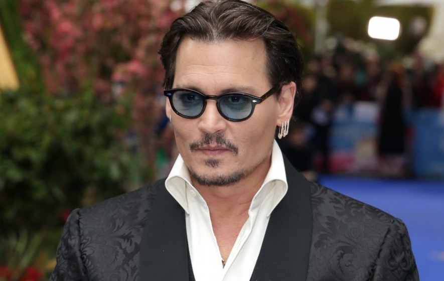Johnny Depp sues former business managers for $25 million on day his divorce is finalised