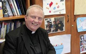 Bishop hugs historical institutional abuse survivor at Mass