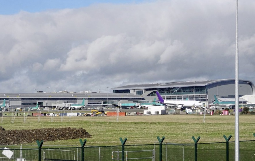 Airline worker facing immigration charges 'has links with organised criminals'