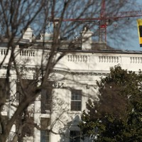 Greenpeace activists scaled a crane behind the White House to protest against Trump