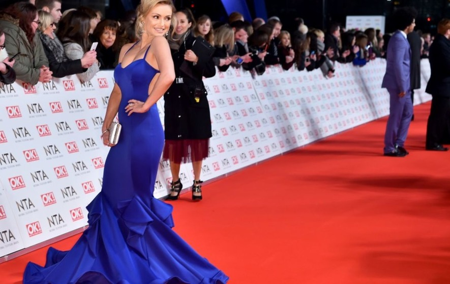 Ola Jordan dazzles on the red carpet as she leads the early arrivals at the National TV Awards