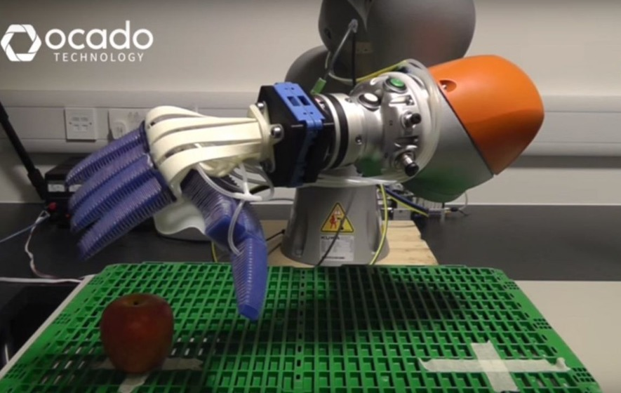 This robot arm is surprisingly good at picking up fruit