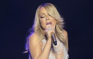 Video: Watch as Mariah Carey burns her wedding dress