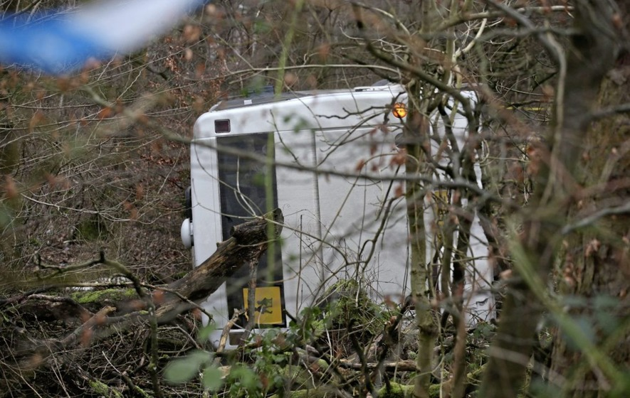 Five pupils in hospital after school bus crashes down embankment