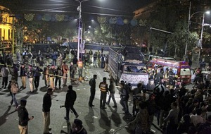 Police and pharmacists among dead as suicide bomber targets Pakistan rally
