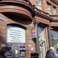 First Trust Bank to shut half its branches