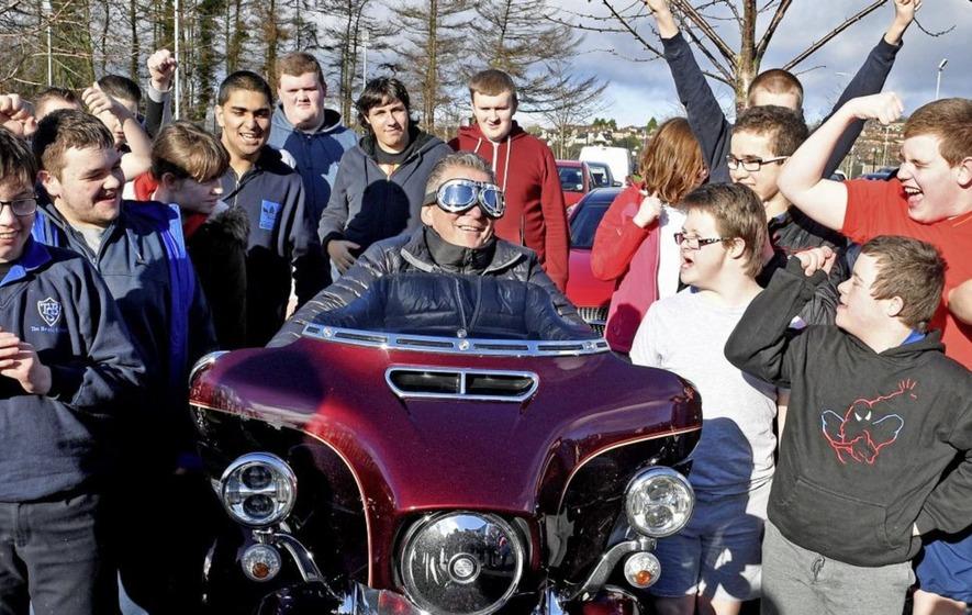 School principal with motor neurone disease surprised by Harley Davidson bikers