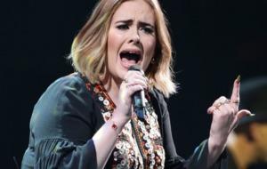 Singer Adele tells Australian audience: 'I'm married now'