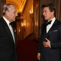 Tom Cruise shares a chuckle with the Duke Of Edinburgh at Buckingham Palace