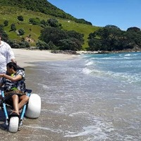 Teenager with cerebral palsy enjoys the ocean for the first time in years after special beach wheelchair gift