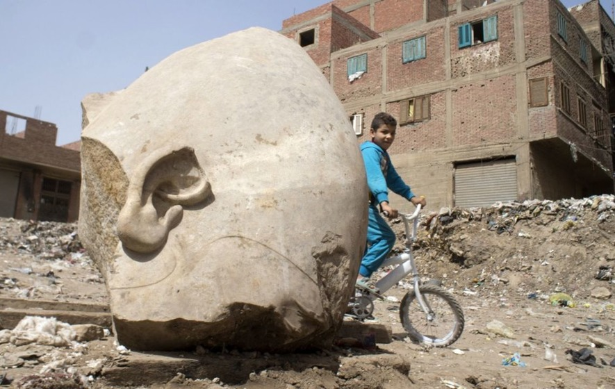 A massive statue of Ramses II has been unearthed at a slum in Cairo