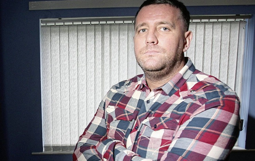 Former footballer turned loyalist paramilitary attacked with hammers