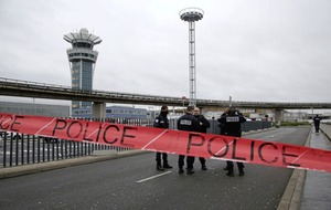 Father of Paris airport attacker released as postmortem held