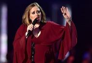 Adele stands up for her dancing fans at Melbourne gig