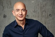Here's Jeff Bezos trying out an enormous robot because billionaires have all the fun