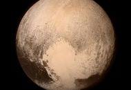 A bunch of scientists are very keen to help Pluto regain its planet status