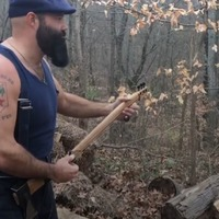 This musician plays guitar on an axe, then splits wood with it and it's taking multitasking to the next level