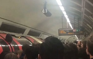 This tube worker got into a very awkward situation involving his head and a carriage door