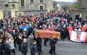 Ryan McBride was 'an inspirational leader' and 'great role model', mourners told