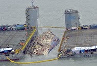 South Korean ferry that sank killing 300, lifted from the water after nearly three years