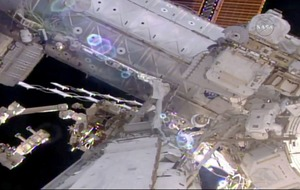 Astronauts embark on spacewalk to prepare new parking spot at station