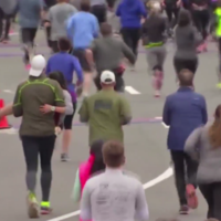 Watch the heart-warming moment an exhausted half-marathon runner gets carried to the finish line