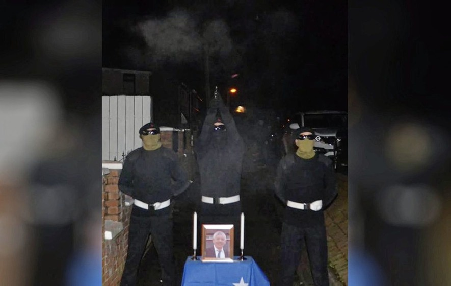 Police investigate after picture shows masked man appearing to fire shots in tribute to republican