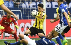 A Borussia Dortmund fan was pictured sitting alone in the Schalke end, and Marc Bartra wants to give her his shirt