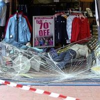 Window destroyed during burglary at clothing shop