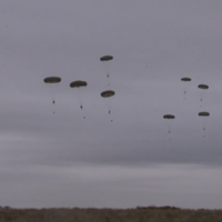 Watch as dozens of troops parachute from planes as part of an Army, RAF and Navy training exercise