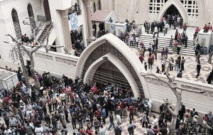 37 killed in Islamic State bomb attacks on Egyptian churches