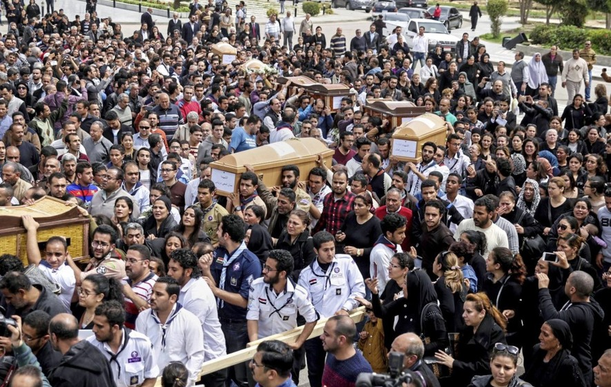Egyptian Christians bury bomb attack victims as state of emergency takes effect