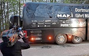 Dortmund player Marc Bartra injured after explosions damage team bus