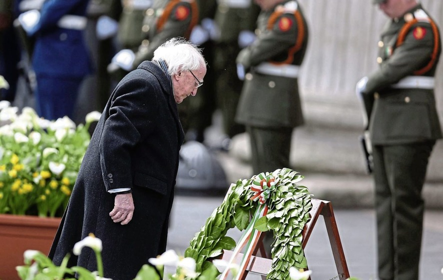 Ireland's president Michael D Higgins lays a wreath at Rising focal point