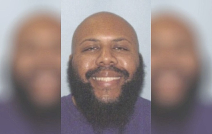 Man who posted apparent shooting of elderly passer-by on Facebook wanted for murder