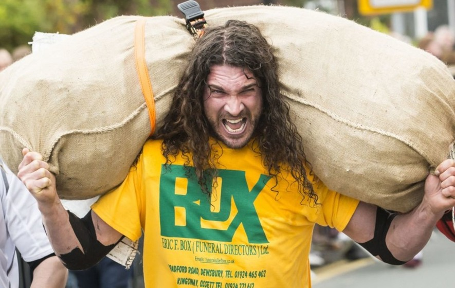 The World Coal Carrying Championships are exactly as intense as this man's face suggests