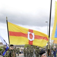 Dozens of men and women in Derry paramilitary-style parade