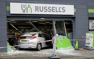 Shoppers on Lisburn Road have lucky escape as car crashes through front of store
