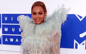 Check out this sweet snap of Blue Ivy kissing Beyonce's bump